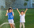 excited kids has fun playing in water fountain in the park - PhotoDune Item for Sale