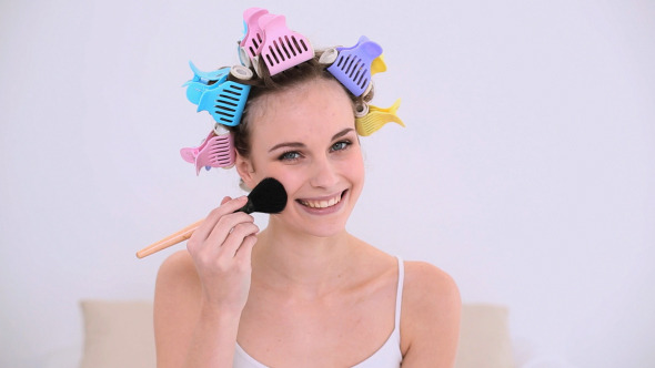 Young Model In Hair Rollers Putting Make Up On