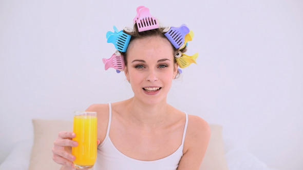 Young Model In Hair Rollers Drinking 1