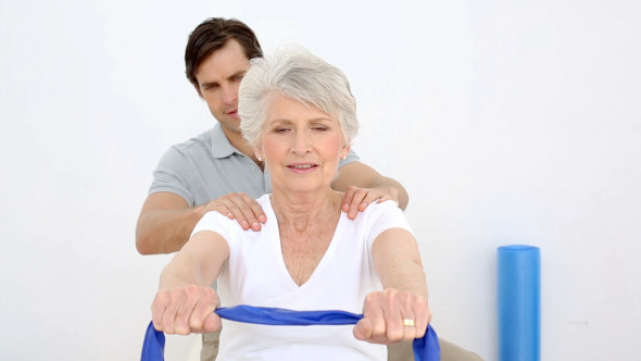 Physiotherapist Checking Senior Patients Shoulder 2