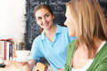 Waitress In Cafe Serving Customer With Coffee - PhotoDune Item for Sale
