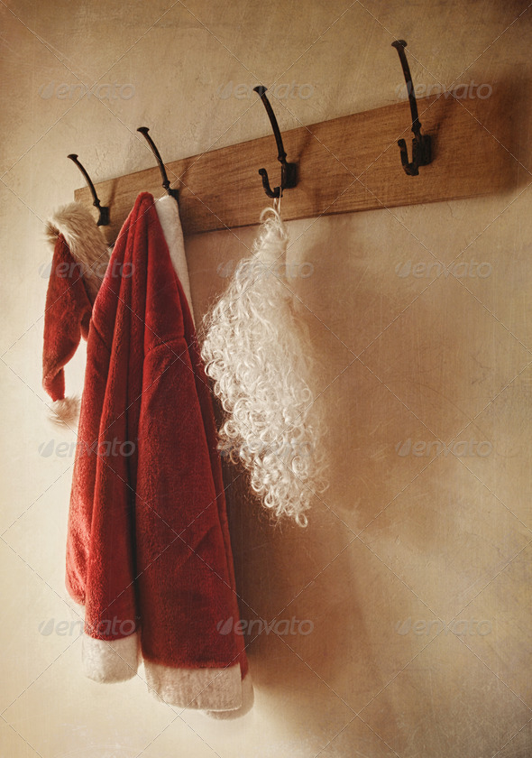 Santa costume hanging on coat rack - Stock Photo - Images