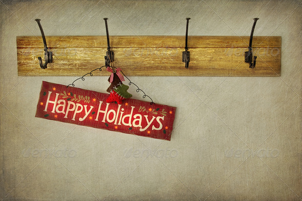 Holiday sign on antique plaster wall - Stock Photo - Images