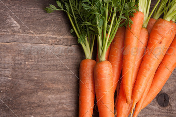 fresh carrot bunch on grungy wooden background - PhotoDune Item for Sale