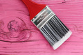 Paint brush on a wooden board pink - PhotoDune Item for Sale