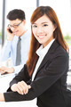 pretty young business woman with colleague in office - PhotoDune Item for Sale