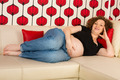 Happy pregnant relaxing on sofa - PhotoDune Item for Sale
