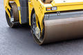 Steamroller at asphalt pavement works - PhotoDune Item for Sale