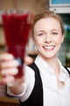 Beautiful woman toasting or serving a beverage - PhotoDune Item for Sale