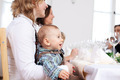 Babyboy Sitting On Mother's Laps At Restaurant Table - PhotoDune Item for Sale