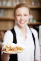 Waitress Offering Pastry In Cafe - PhotoDune Item for Sale