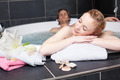 Young Woman Relaxing With Man In Jacuzzi - PhotoDune Item for Sale