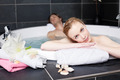 Woman Relaxing With Man In Jacuzzi - PhotoDune Item for Sale
