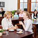 Two women enjoying refreshments in a restaurant - PhotoDune Item for Sale