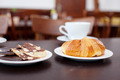 Croissant And Chocolates With Crackers On Table - PhotoDune Item for Sale