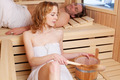 Woman ladling water in a sauna - PhotoDune Item for Sale