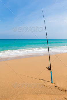 Fishing rod in sand of tropical beach - PhotoDune Item for Sale