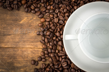 Coffee cup and coffee beans on a wooden table - PhotoDune Item for Sale