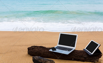 Laptop ,tablet and smartphone on the beach in summer time - PhotoDune Item for Sale