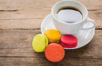 French colorful macarons with cup of coffee - PhotoDune Item for Sale