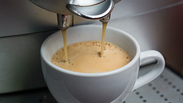 Coffee Machine Making Espresso into a Cap 817