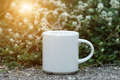 morning coffee with white cup on the grass. - PhotoDune Item for Sale