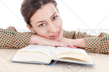 woman in shirt leaning on book and dreamy looking straight in ca - PhotoDune Item for Sale
