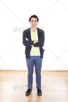 Portrait of casual young man standing with arms crossed - PhotoDune Item for Sale