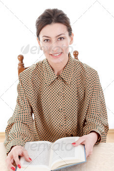 women sitting with book and looking in camera - PhotoDune Item for Sale