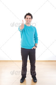 Attractive happy young man standing showing thumb - PhotoDune Item for Sale