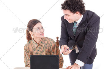 Boss and smiling secretary working together on laptop computer - PhotoDune Item for Sale