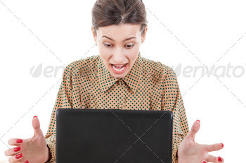 shocked young woman sitting and using laptop - PhotoDune Item for Sale