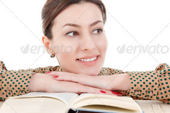 beautiful woman leaning on book looking aside - PhotoDune Item for Sale