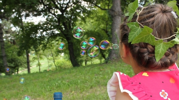 Little Girl Making Bubbles 3