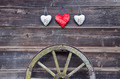 old barn wooden wall with hearts and carriage wheel - PhotoDune Item for Sale