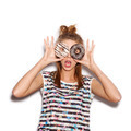 Playful girl holding donuts on her eyes - PhotoDune Item for Sale