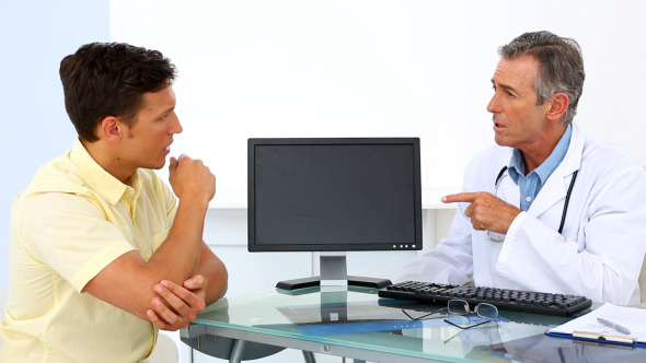 Patient Explaining Elbow Pain To His Doctor