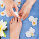 Pedicurist Applying Plain Varnish On Woman's Toenail - PhotoDune Item for Sale