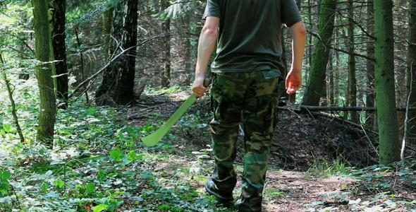 Man With Machete In Forest