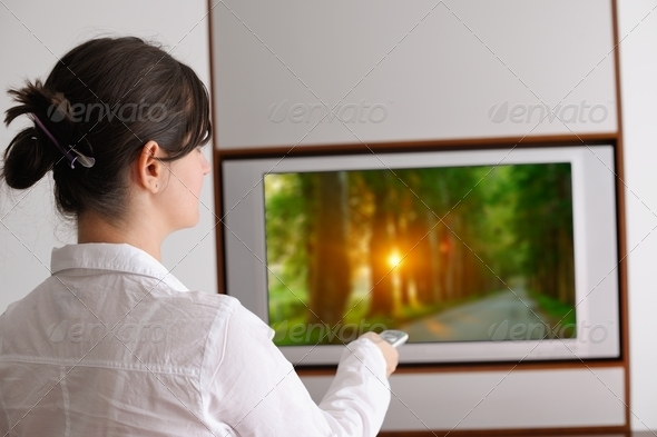 young woman watching tv at home - Stock Photo - Images