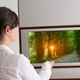 young woman watching tv at home - PhotoDune Item for Sale