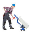 Worker Suffering From Backache While Pushing Machinery - PhotoDune Item for Sale