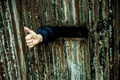 Thumb up shown by a person captive in prison - PhotoDune Item for Sale