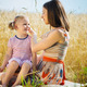 Young mother with cute daughter at wheat field - PhotoDune Item for Sale