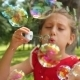 Little Girl Playing With Bubbles 2 - VideoHive Item for Sale