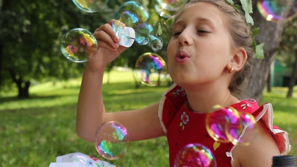 Little Girl Playing With Bubbles 3