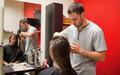 Male hairdresser cutting hair