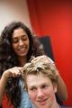 Portrait of a female hairdresser cutting hair