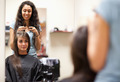 Woman combing the hair of a customer - PhotoDune Item for Sale