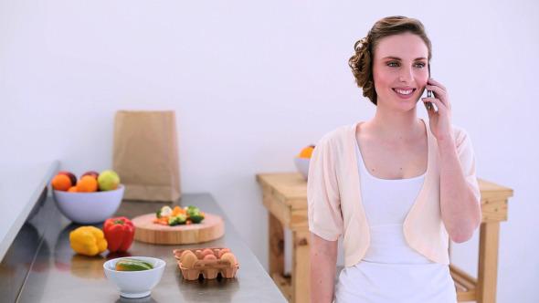 Pretty Model Standing In Kitchen Chatting